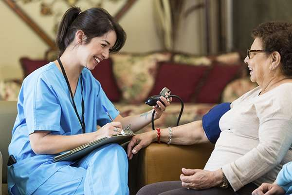 home-caregiver-taking-vitals-on-senior-woman_iStock_000091579603