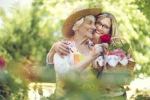 family caregiver with elderly loved one in a garden