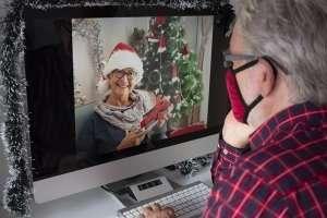senior man on virtual video Christmas call