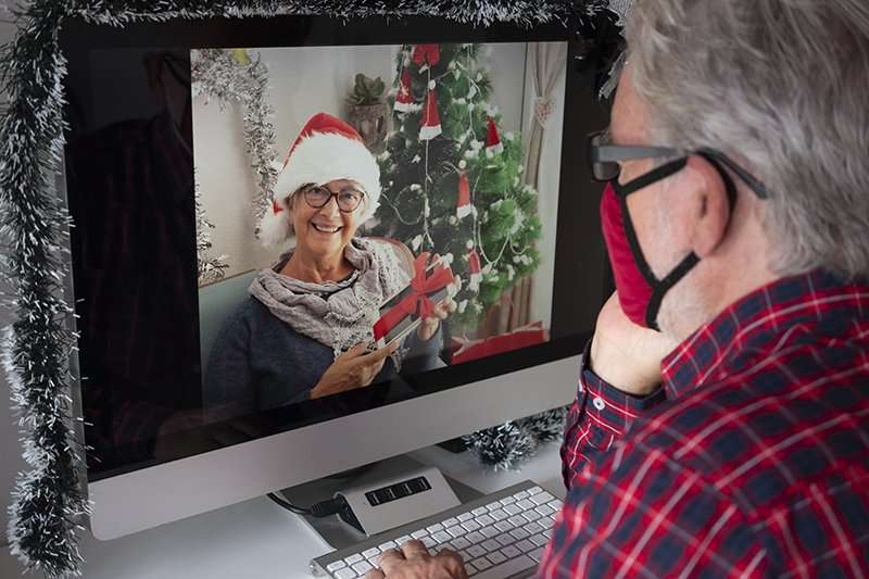 senior man on virtual video Christmas call
