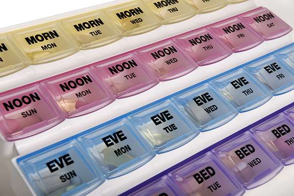 Color-coded pill organizer for medication management